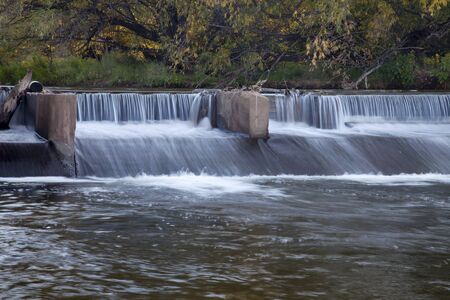 river dam diverting water for farmland irrigation, Cache la Poudre RIver in Fort Collins, Colorado, fall scenery Stok Fotoğraf