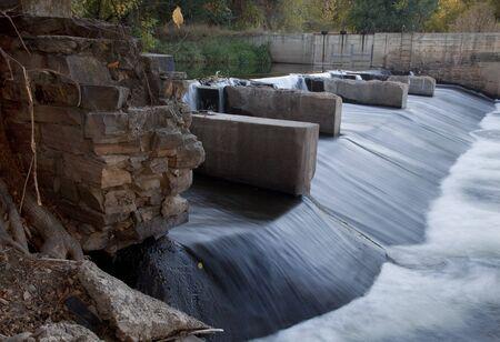 cache la poudre: river dam diverting water for farmland irrigation, Cache la Poudre RIver in Fort Collins, Colorado, fall scenery Stock Photo