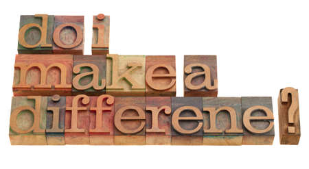 Do I make a difference? A question in vintage wooden letterpress printing blocks isolated on white.