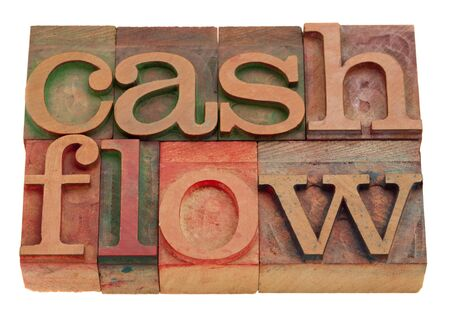 cash flow words in vintage wooden letterpress type isolated on white photo
