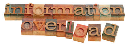 too much information or information overload concept - words in vintage wooden letterpress type isolated on white Stock Photo - 8096110