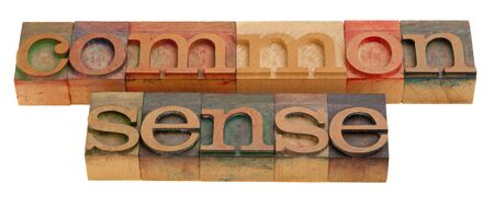 sense: common sense - words in vintage wooden letterpress printing blocks isolated on white