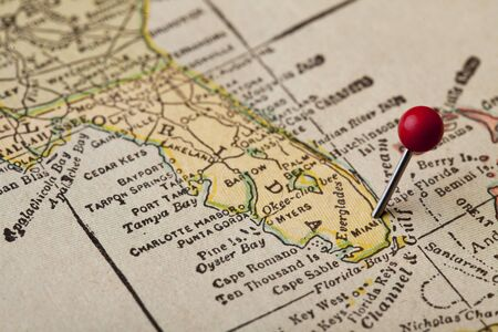 Florida vintage 1920s map (printed in 1926 - copyrights expired) with a red pushpin on Miami, selective focus Imagens