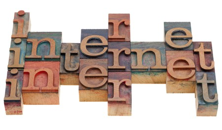 internet word abstract in vintage wooden letterpress printing blocks isolated on white Stock Photo - 8178695