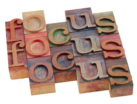 focus word abstract in vintage wooden letterpress printing blocks isolated on white Stock Photo - 8178679