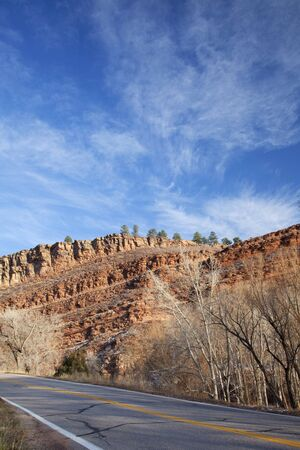 redstone: highway in northern Colorado near Fort Collins with redstone cliffs, late fall scenery Stock Photo
