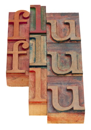 flu word abstract - vintage wooden letterpress blocks isolated on white Stock Photo - 8178673