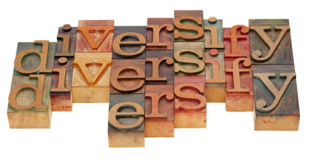 diversify: diversification concept - word abstract in vintage wooden letterpress blocks isolated on white