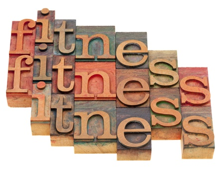 fitness concept - word abstract in vintage wooden letterpress blocks isolated on white Stock Photo - 8264996