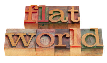 flat world, globalization concept - words in vintage wooden letterpress printing blocks isolated on white Stock Photo - 8265000