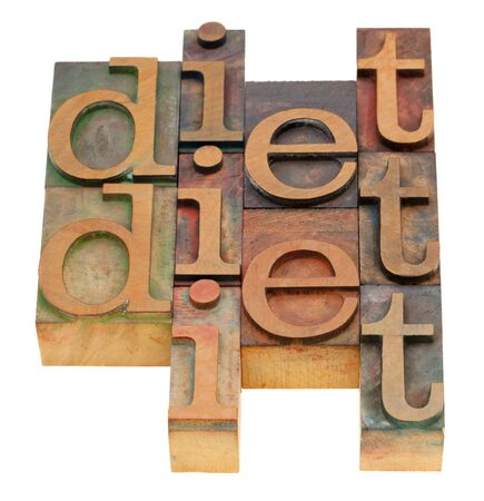 diet word abstract in vintage wooden letterpress printing blocks isolated on white Stock Photo - 8265007