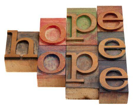 hoopt: hoop dat woord abstract in vintage houten boekdruk afdruk blokken geïsoleerd op wit  Stockfoto