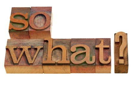 So what? A question or statement in vintage wooden letterpress printing blocks isolated on white Stock Photo - 8265021