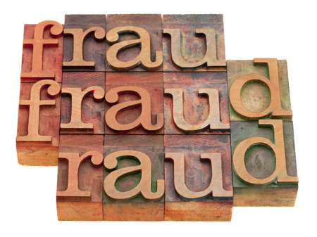 fraud word abstract in vintage wooden letterpress printing blocks isolated on white Stock Photo - 8323682