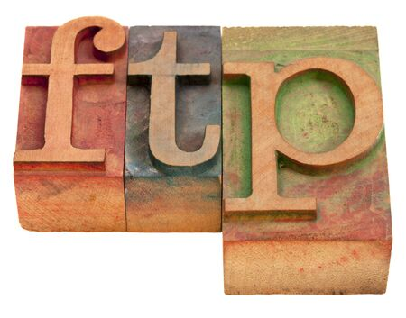 ftp (file transfer protocol) - word in vintage wooden letterpress printing blocks isolated on white photo