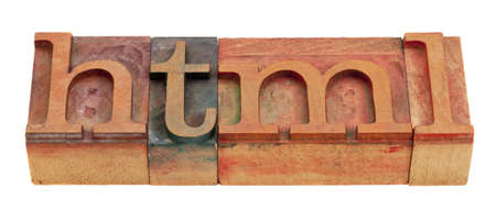 html: html (hyper text markup language) -  word in vintage wooden letterpress printing blocks isolated on white Stock Photo