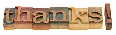 thanks - word in vintage wooden letterpress printing blocks isolated on white photo