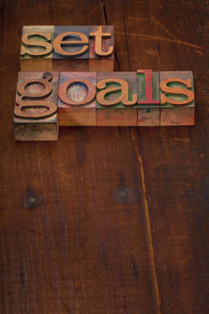 set goals - text in vintage wooden letterpress printing blocks against old grunge wooden background Stock Photo - 8323690