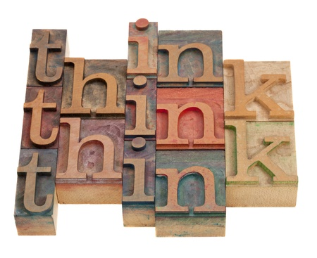 think word abstract in vintage wooden letterrpress printing blocks isolated on white photo