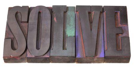 word in antieke boekdruk blokken, gekleurd door kleur inkt, geïsoleerd op wit afdrukken oplossen Stockfoto