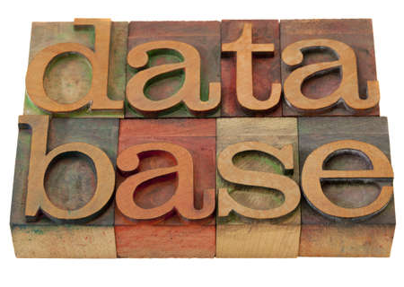 databade word in vintage wooden letterpress printing blocks, stained by color inks, isolated on white Banco de Imagens
