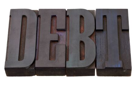 debt word in vintage wooden letterpress printing blocks, stained by color inks, isolated on white Stock Photo - 8471651