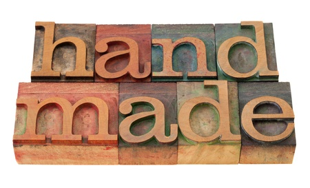 handmade word in vintage wooden letterpress printing blocks, stained by color inks, isolated on white Stock Photo - 8471656