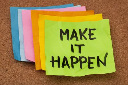 make it happen, motivational slogan, colorful sticky notes on cork bulletin board