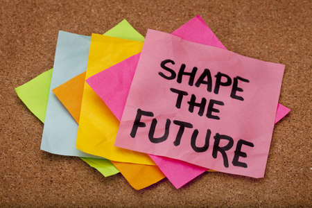shape the future, motivational slogan, colorful sticky notes on cork bulletin board Stock Photo - 8533302