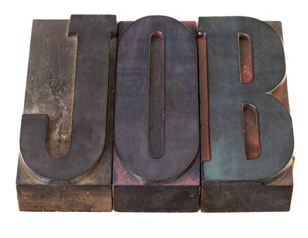 job - word in vintage wooden lettepress prinitng blocks, stained by color inks, isolated on white Stock Photo - 8533321