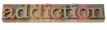 addiction word  in vintage wooden letterpress printing blocks, stained by color inks, isolated on white Stock Photo - 8554155