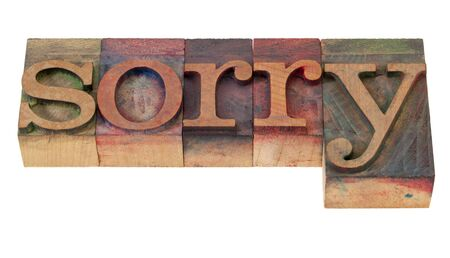sorry - word in vintage wooden letterpress printing blocks, stained by color inks, isolated on white Stock Photo - 8554157