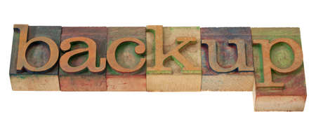 backup - word in vintage wooden letterpress printing blocks, stained with color inks, isolated on white Stock Photo - 8554166