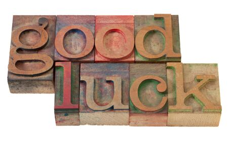 good luck- phrase  in vintage wooden letterpress printing blocks, stained with color inks, isolated on white Stock Photo - 8554170