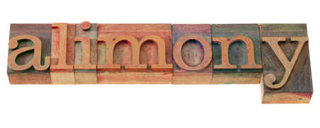 alimony: alimony word in vintage wooden letterpress printing blocks, stained by color inks, isolated on white Stock Photo