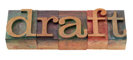 draft  word in vintage wooden letterpress printing blocks, stained by color inks, isolated on white photo