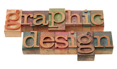 graphic design word abstract in vintage wooden letterpress printing blocks, stained by color inks, isolated on white photo