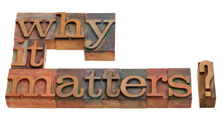 Why it matters? A question in vintage wooden letterpress printing blocks, isolated on white