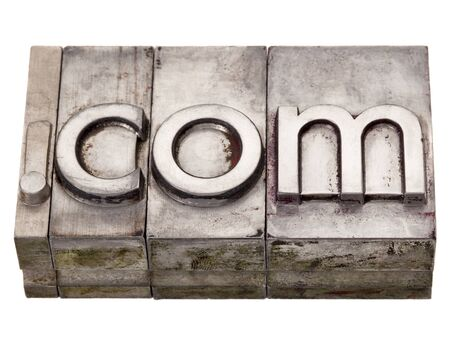 domains: dot com internet domain extension in vintage grunge metal letterpress printing blocks, stained by color inks, isolated on white Stock Photo