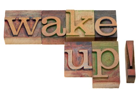 wake up - exclamation phrase in vintage wooden letterpress printing blocks, stained by color inks, isolated on white photo