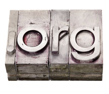 nonprofit: dot org - non-profit organization internet  domain extension in vintage grunge metal letterpress printing blocks, stained by color inks, isolated on white Stock Photo