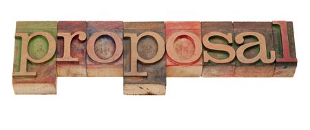 proposal word in vintage wooden letterpress printing blocks, stained by color inks, isolated on white photo