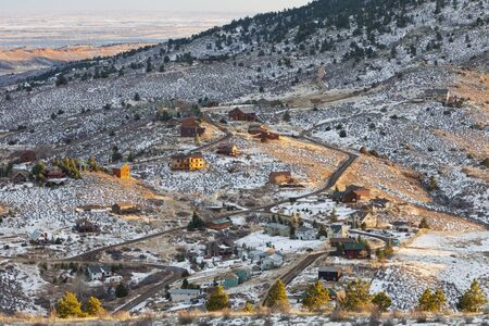 collins: residential houses on slopes of Rocky Mountains near Fort Collins, Colorado, winter afternoon scenery Stock Photo