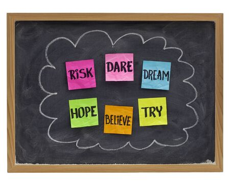 to believe: motivational concept (hope, believe, dare, risk, try,dream) - sticky notes on blackboard Stock Photo