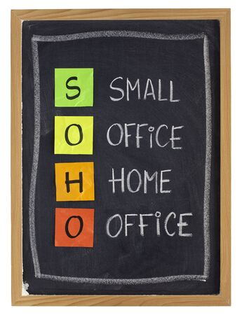 virtual office concept - SOHO acronym (small office, home office) - white chalk handwriting and sticky notes on blackboard, isolated on white Stock Photo - 8612735