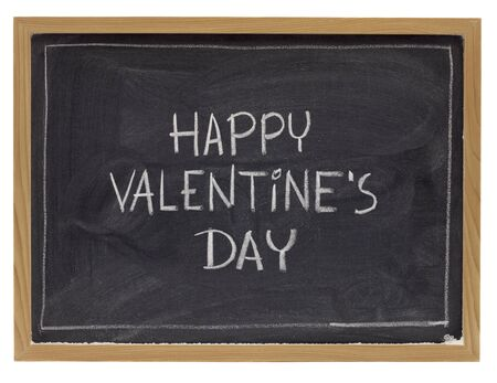 happy valentine day - white chalk handwriting on blackboard, isolated on white photo