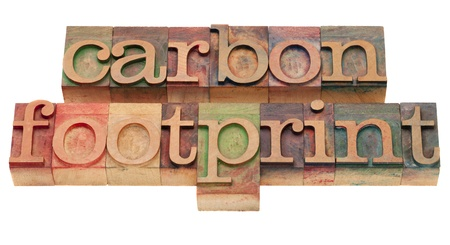 carbon footprint - word sin vintage wooden letterpress printing blocks, stained by color inks, isolated on white