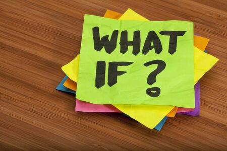 what if: what if question - stack of color sticky notes on wooden (bamboo) background