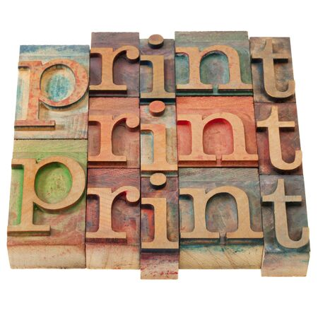print word abstract in vintage wooden letterpress printing blocks, stained by color inks, isolated on white photo