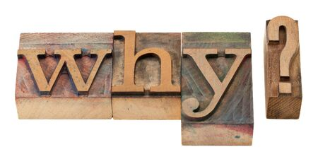 why question in vintage wooden letterpress printing blocks, stained by color inks, isolated on white photo